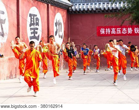 The Group Of Shaolin Children Monk Was Training Kungfu Inside The Original Shaolin Temple. Dengfeng
