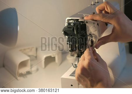 Repairman Master Is Collecting And Testing Sewing Machine After Repairing Inserting Details In Works