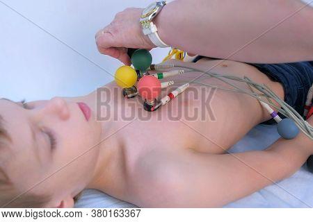 Doctor Cardiologist Preparing Child Boy To Cardiogram Heart Procedure, Closeup. Woman Cardiologist M