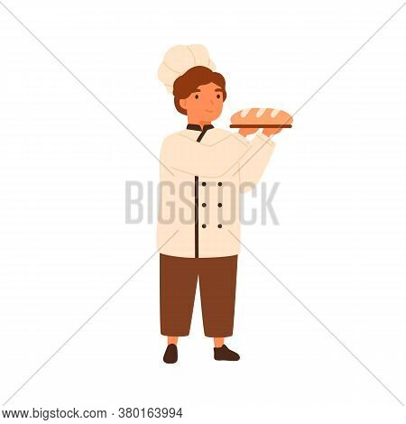 Adorable Child, Cute Boy In Chef Baker Uniform. Boy In Cooking Toques, Serving Wheat Bread, Baguette