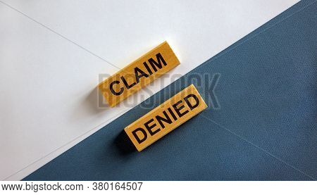 'claim Denied' Words On Wooden Blocks. Business Concept. Beautiful White And Blue Background. Copy S