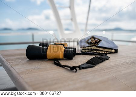 Captains Hat And Binoculars On A Yacht.