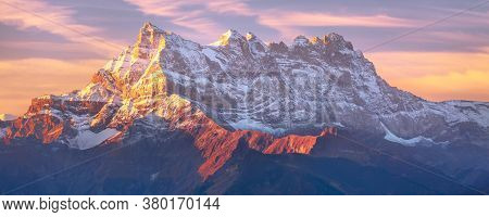 Sinrise Or Sunset Panoramic Banner View Of The Dents Du Midi In The Swiss Alps, Canton Vaud, Switzer