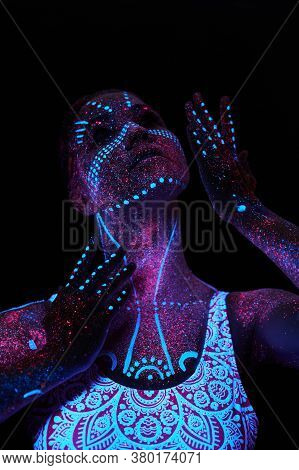 Woman Does Yoga, Hand Movement, Body Warm-up. Art Girl Cosmos In Ultraviolet Light. Entire Body Is C
