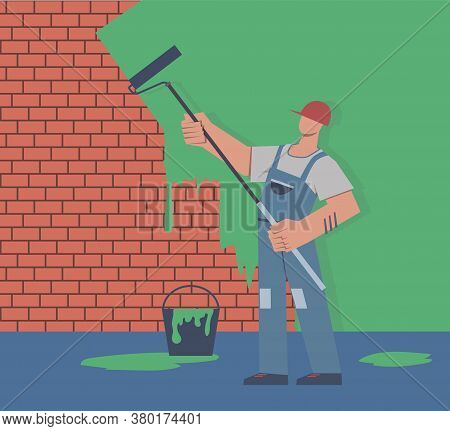 Painter Colors Wall. Repair In Apartment, Man In Uniform Is Holding Paint Roller In Hand, Profession