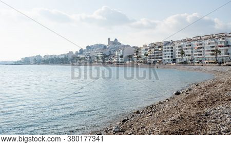 Stone Beach With View On Sunny Altea City Coastline With Hill And Church, Costa Blanca, Spain