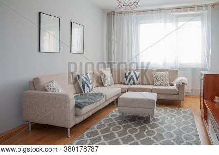 Scandinavian Minimalism Design. Beautiful Living Room Decorated In The Grey And Beige Colors. Comfor