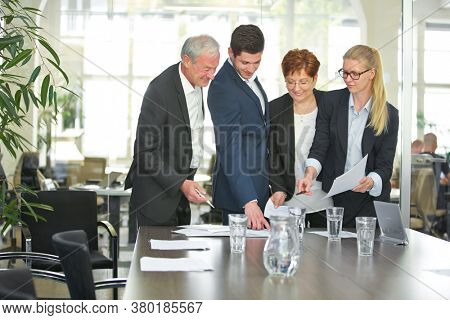 Negotiation of contract at business team meeting in the conference room