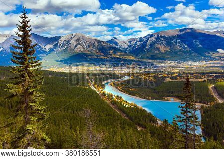 Majestic panorama of a valley in the Rocky Mountains. Lush multicolor autumn in the Canadian Rockies. The concept of active, ecological and photo tourism