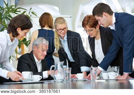 Business people negotiate a draft contract in a business meeting