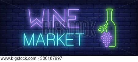 Wine Market Neon Text And Bottle With Bunch Of Grapes. Winery Or Wine Shop Advertisement Design. Nig