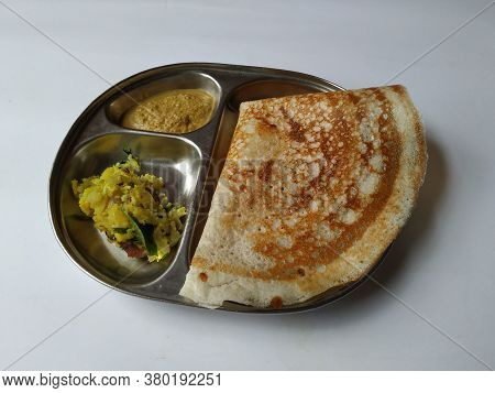 Indian Homemade Breakfast Tasty Masala Dosa With Coconut Chutney And Potato Masala In A Plate Isolat