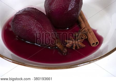 Poached Pears In Red Wine With Cinnamon. Dessert With Fruits, Italian Kitchen Recipe.