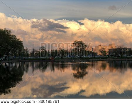 The Expanse Of The Lake With Clouds Reflected In It, Illuminated By Sunset. Beautiful Clouds At Suns