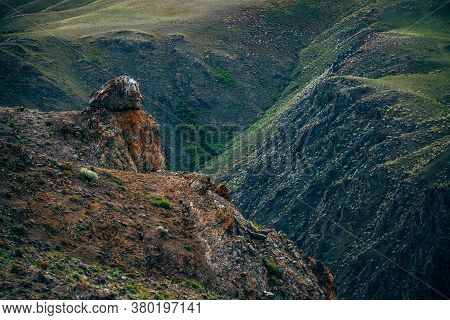 Awesome Vivid Mountain Landscape With Big Stone On Cliff Above Deep Precipice. Multicolor Clay Mount