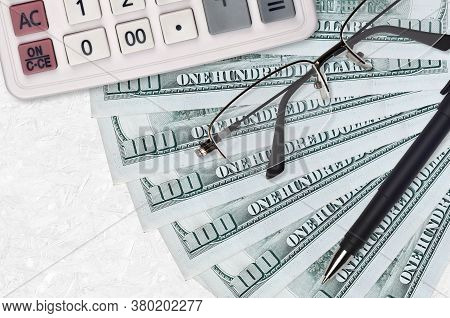 100 Us Dollars Bills Fan And Calculator With Glasses And Pen. Business Loan Or Tax Payment Season Co