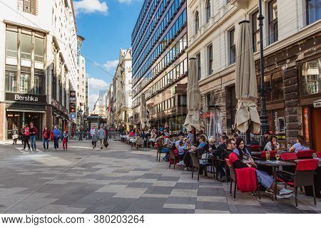 Budapest, Hungary. October 2019: Tourists And Visitors Sitting In Summer Cafe On The Vorosmarty Squa