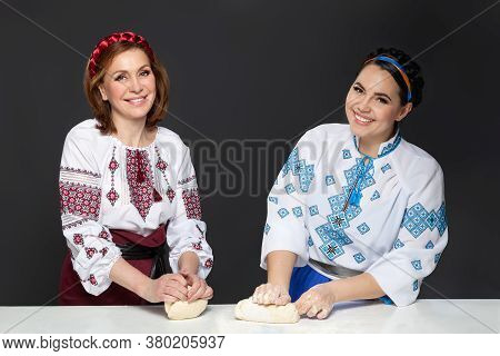 Two Adult Woman In Traditional Ukrainian Style. Cooking Ukrainian Varenyky. Serie.