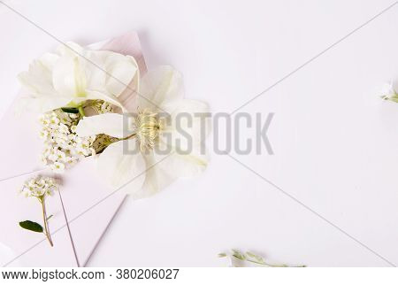 White Romantic Holiday Flowers, Clematis, Pink Envelope Full Of Flowers, Wedding, Love Concept