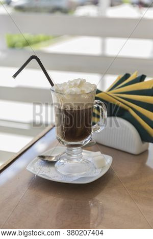 Delicious And Flavorful Cappuccino Coffee Was Served In The Cafe In A Transparent Glass, With Foam A