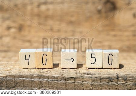 Wooden Cubes From 4G To 5G With Black Arrow Pointing On Wooden Background, Mobile Or Technology Conc