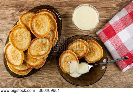 Dish With Pancakes, Homemade Small Pancakes Poured Condensed Milk, Teaspoon In Brown Saucer, Bowl Wi