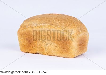 A Loaf Of Fresh Crusty Bread On A White Background