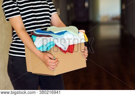 Woman Holding A Donate Box. Donation Box For Giving. Sharity Social Activity. Cardboard Box With Clo