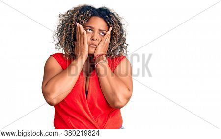 Young african american plus size woman wearing casual style with sleeveless shirt tired hands covering face, depression and sadness, upset and irritated for problem
