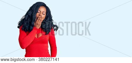 Beautiful african american woman wearing casual clothes bored yawning tired covering mouth with hand. restless and sleepiness.