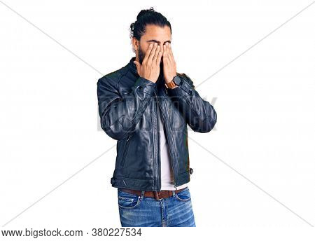Young arab man wearing casual leather jacket rubbing eyes for fatigue and headache, sleepy and tired expression. vision problem