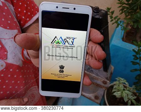 District Katni, India - May 23, 2020: Woman Holding Smart Phone With Displayed Atal Mission For Reju