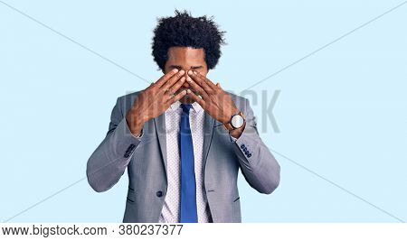 Handsome african american man with afro hair wearing business jacket rubbing eyes for fatigue and headache, sleepy and tired expression. vision problem