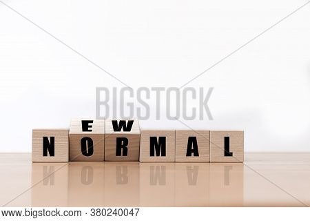 Flipping Wooden Block Cubes For New Normal Working. The World Is Changing To Balance It Into New Nor