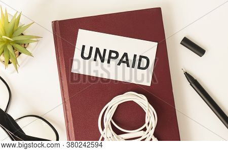 Unpaid. Text In Light Box. Pink Coffee Mug On Gray Background
