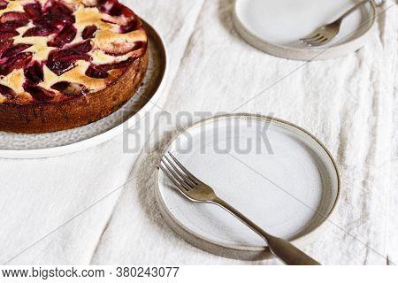 Homemade Ricotta Plum Cake On Beige Linen Tablecloth. Cottage Cheese Casserole With Vanilla, Semolin