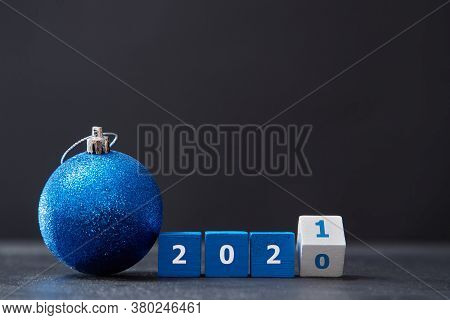 New Year And Xmas Celebration. Winter Holiday. Xmas Decorations. Wooden Cubes With Number, Ball With