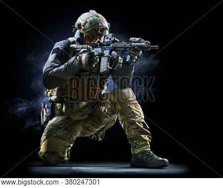 Army Soldier In Protective Combat Uniform Holding Special Operations Forces Combat Assault Rifle On