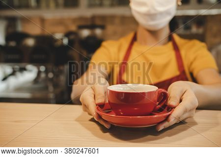 Friendly Waitress Woman Wearing Protection Face Mask Waiting For Serving Hot Coffee Cup To Customer
