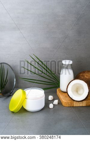 Open Spa Cream For Body Skincare And Hair With Coconut Oil, Fresh Coconuts, Palm Leaf And Bottle Wit