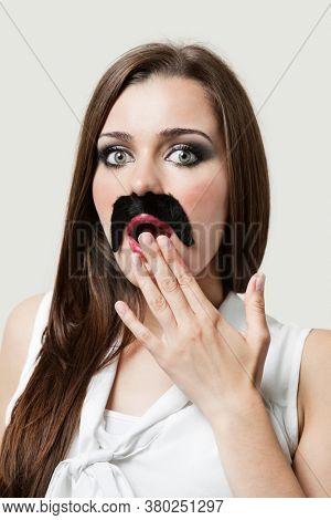Shocked Woman wearing fake moustache