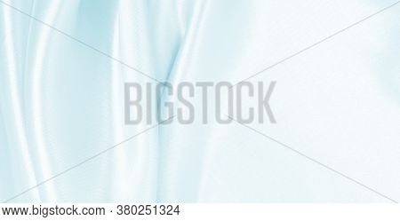 Smooth Elegant Blue Silk Or Satin Luxury Cloth Texture Can Use As Abstract Background. Luxurious Bac
