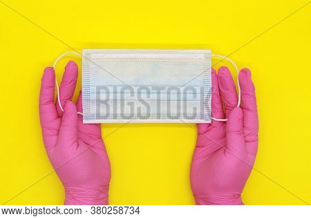 Disposable Latex Glove. The Pink Gloves. The Nurse's Gloved Hands Are On The Table. Disposable Surgi
