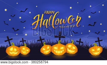 Jack O Lanterns On Halloween Background. Smiling Pumpkins On A Cemetery With A Gravestone And Crosse