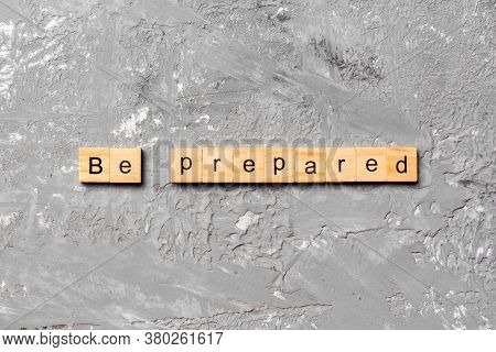 Be Prepared Word Written On Wood Block. Be Prepared Text On Cement Table For Your Desing, Concept