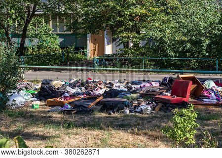 Environmental Pollution. Garbage Dump On The Grass Near A Multi-storey Building In A Big City, Pollu