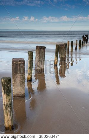 Groynes In The Sand & Sea At Burnham On Sea, Somerset