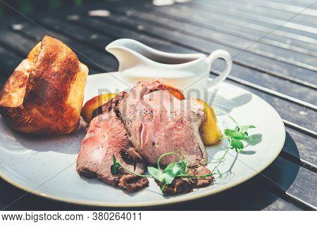 Sunday Roast With Marinated Lamb Rump, Beef Dripping Roast Potatoes, Yorkshire Puddings, And Gravy.