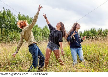 Summer Holidays Vacation Happy People Concept. Group Of Three Friends Boy And Two Girls Dancing And