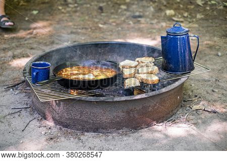 Breakfast Cooking On A Fire Pit While Camping